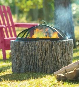 Faux Tree Stump Fire Pit With Spark Guard, Grate And Poker photo